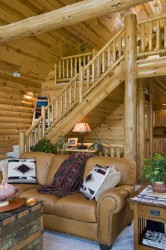 Log Home By Golden Eagle Log and Timber Homes - golden eagle log logs cabin home homes house houses rustic knotty pine custom design designs designer floor plan plans kit kits building luxury built builder complete package packages close up image of log railing on stairway and loft balcony cathedral ceiling 8 inch half log on walls wp4 1x8 pine on ceiling log cabins