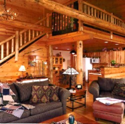 Log Home By Golden Eagle Log and Timber Homes - golden eagle log logs cabin home homes house houses rustic knotty pine custom design designs designer floor plan plans kit kits building luxury built builder complete package packages interior view of a loft railing and stair way in a small log cabin kit stairwey
