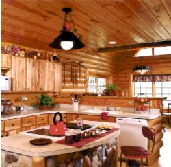 Log Home By Golden Eagle Log and Timber Homes - golden eagle log logs cabin home homes house houses rustic knotty pine custom design designs designer floor plan plans kit kits building luxury built builder complete package packages interior view of a kitchen in a small log cabin kit island stove