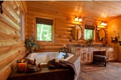 Log Home By Golden Eagle Log and Timber Homes - golden eagle log logs cabin home homes house houses rustic knotty pine custom design designs designer floor plan plans kit kits building luxury built builder complete package packages elegant master bedroom with comfortable soaking tub wood ceiling rounded log walls granite hickory vanity