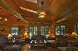 Log Home By Golden Eagle Log and Timber Homes - golden eagle log logs cabin home homes house houses rustic knotty pine custom design designs designer floor plan plans kit kits building luxury built builder complete package packages interior view western themed decor well appointed grand great room log ceiling beams skylight hand scraped wood flooring
