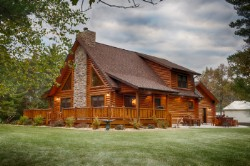 Log Home By Golden Eagle Log and Timber Homes - golden eagle log logs cabin home homes house houses rustic knotty pine custom design designs designer floor plan plans kit kits building luxury built builder complete package packages attached garage dormers saddle notch covered porch corners exterior under 2000 square foot lofted log home