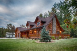 Log Home By Golden Eagle Log and Timber Homes - golden eagle log logs cabin home homes house houses rustic knotty pine custom design designs designer floor plan plans kit kits building luxury built builder complete package packages attached garage dormers saddle notch covered porch corners exterior under 2000 square foot lofted log home fireplace stone rock trapezoid windows triangle a frame