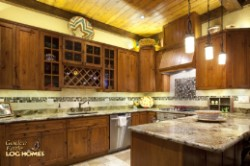 Log Home By Golden Eagle Log and Timber Homes - kitchen area
