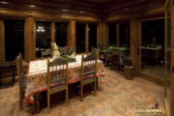 Log Home By Golden Eagle Log and Timber Homes - dining area   at night