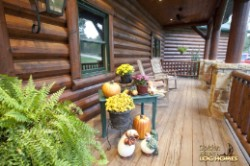 Log Home By Golden Eagle Log and Timber Homes - front porch   daytime