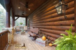 Log Home By Golden Eagle Log and Timber Homes - front porch   view 2   daytime