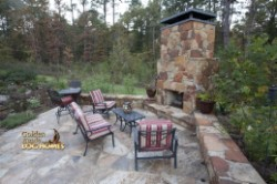 Log Home By Golden Eagle Log and Timber Homes - back yard sitting area