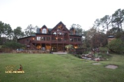 Log Home By Golden Eagle Log and Timber Homes - rear of home view 2