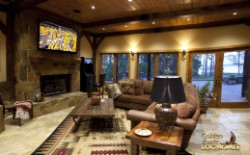 Log Home By Golden Eagle Log and Timber Homes - lower level   family room area