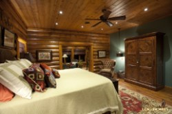 Log Home By Golden Eagle Log and Timber Homes - master bedroom view 4