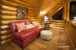 Log Home By Golden Eagle Log and Timber Homes - loft sitting area